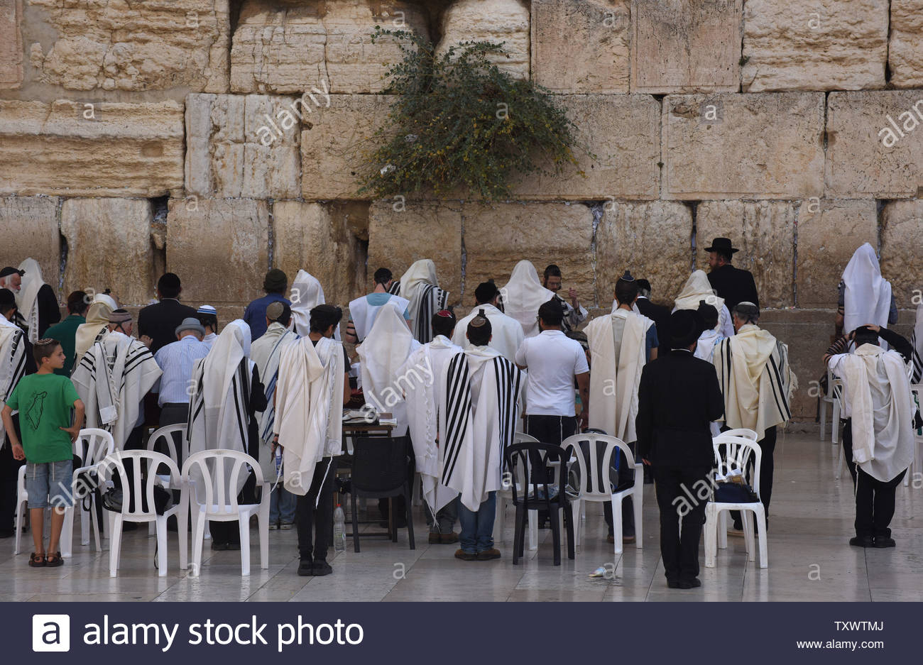 Jews Pray At The Western Wall, Judaism's Holiest Site, In Within What Year Is It According To Jews